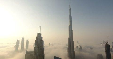 DUBAI, UAE - JANUARY 2, 2017: Aerial view of Burj Khalifa downtown Dubai at sunrise. The Burj al Khalifa is the tallest structure in the world, standing at 829.8 m (2,722 ft). Scenic foggy weather