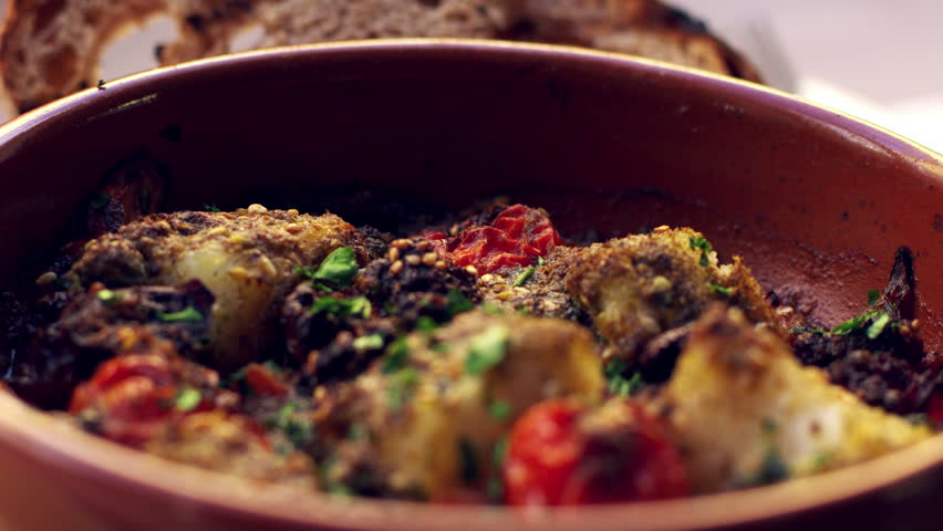 Cod and chorizo bake in earthenware dish, close up rack focus | Shutterstock HD Video #23123473