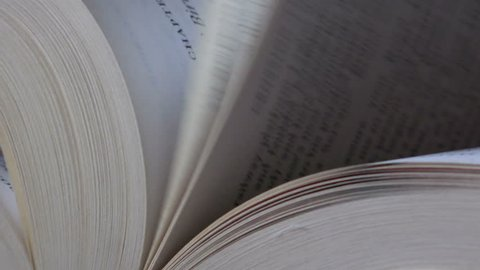 Book pages flipping, close up