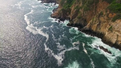 Aerial shot of the ocean in La Quebrada Acapulco Guerrero M\x8Exico