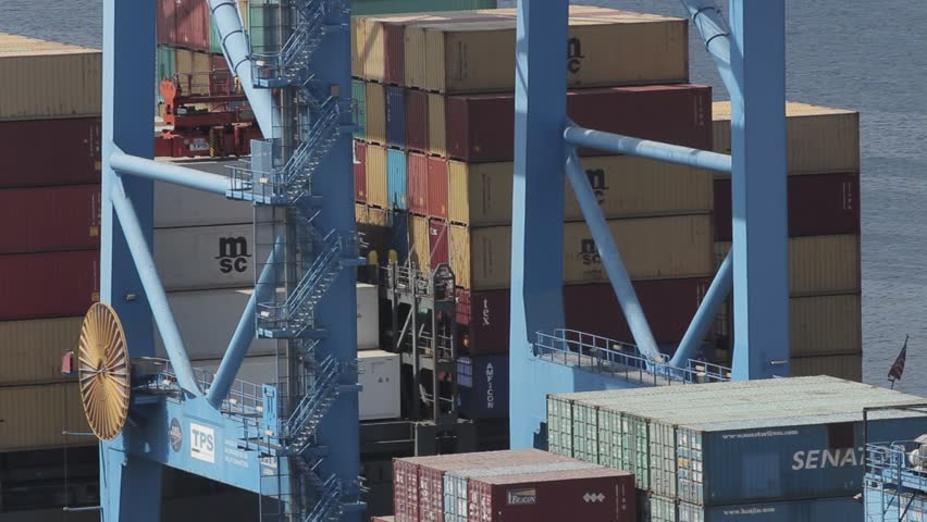 Wide shot of industrial crane moving containers in a seaport shipping yard. Valparaiso, Chile - Feb 2016) | Shutterstock HD Video #23166313