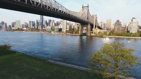 An establishing aerial shot of New York City's Queensboro Bridge at sunrise. Shot during the summer of 2016 in 4k.