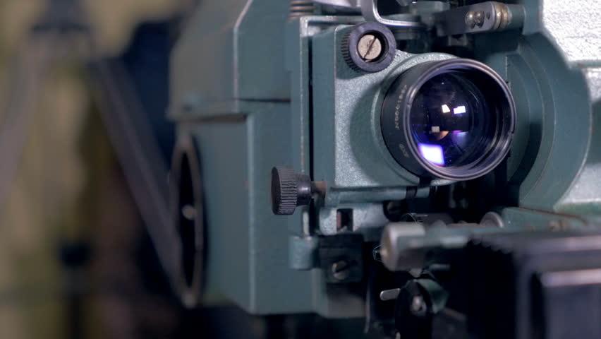 Worker switch on antique Film Projector.   Shutterstock HD Video #23217748