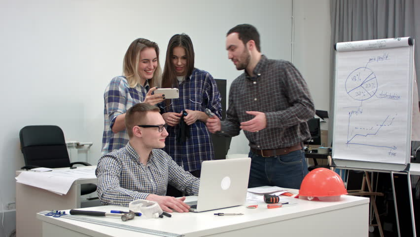 Team of young architects preparing to start new project   Shutterstock HD Video #23276587