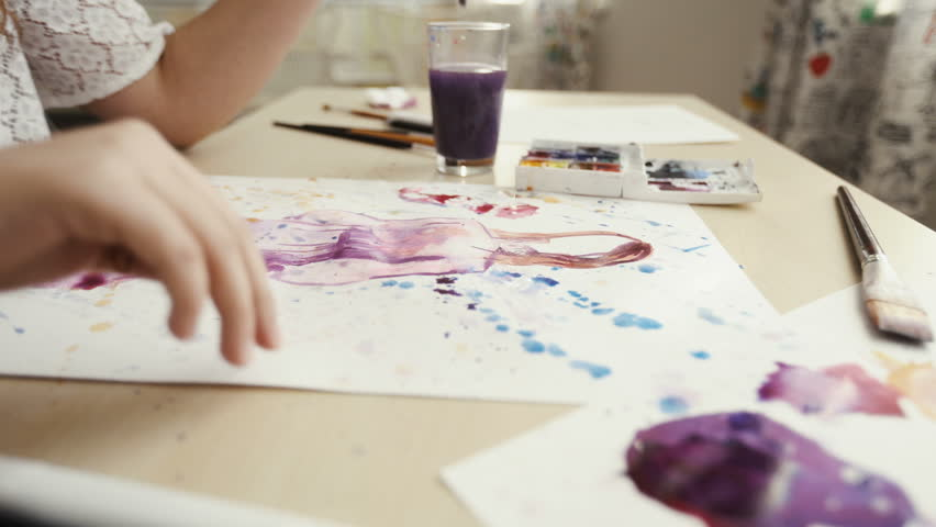 Painting with watercolors. On a white sheet of paper. Female hand artist. The lessons of modern painting. School of the Arts. Lesson fine art