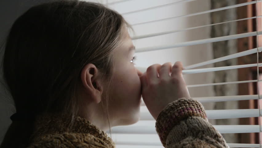 Portrait of child in the window. The boy face close up child through the glass. Sad boy looks out the window.  #23330023