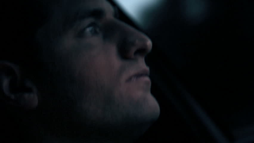 Close up of a man getting tired while driving