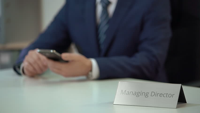 Busy managing director using mobile app on phone, checking business schedule | Shutterstock HD Video #23404783
