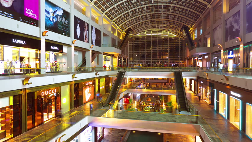 SINGAPORE - MAY 7: (Hyperlapse view) Many people in the mall The Shopps at Marina Bay Sands on May 7, 2012 in Singapore.
