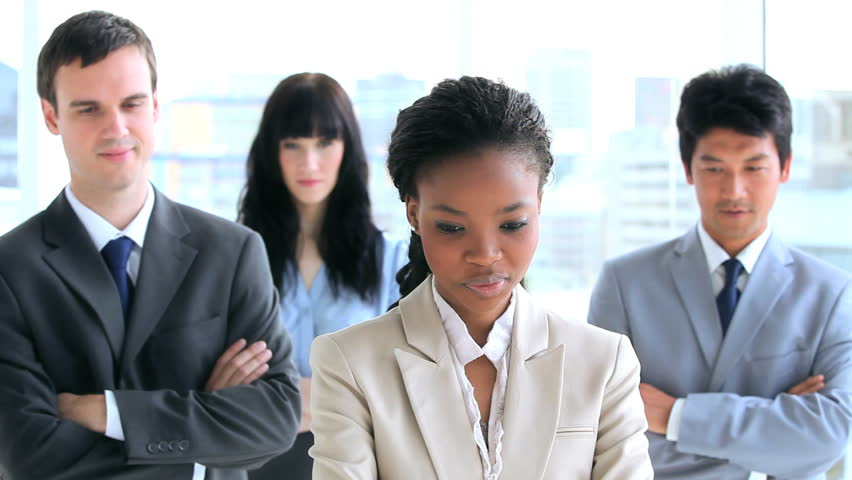 Happy work team standing with their arms crossed in a bright room | Shutterstock HD Video #2342300