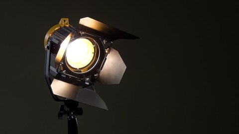 Spotlight with lens. Activation of the device. Power adjustable with dimmer switch. Off.  Photography, videography, filming, shooting.