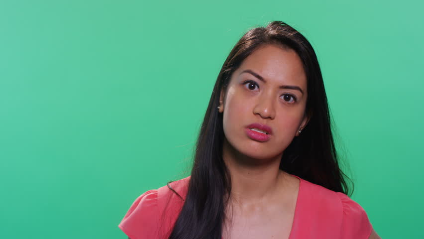 Asian woman on green background talking to camera | Shutterstock HD Video #23436943