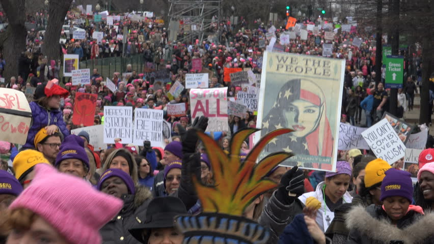 WASHINGTON, DC - JAN. 21, 2017: This is What Democracy Looks Like chant as marchers arrive with banners, part of gigantic turnout that flooded DC in the anti-inauguration Women's March on Washington.