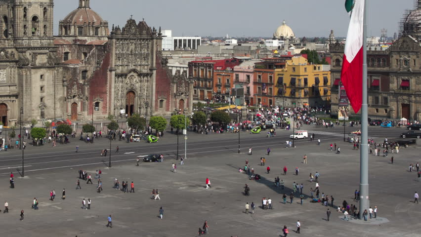 time-lapse of the zocalo in mexico city, with the cathedral and giant flag in the centre