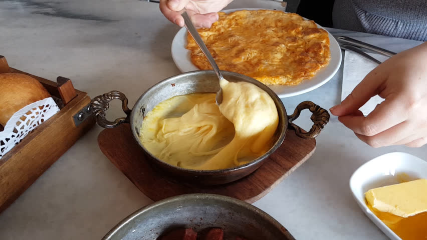 Turkish baked cheese named mihlama and fuem beef meat named pastirma at breakfast