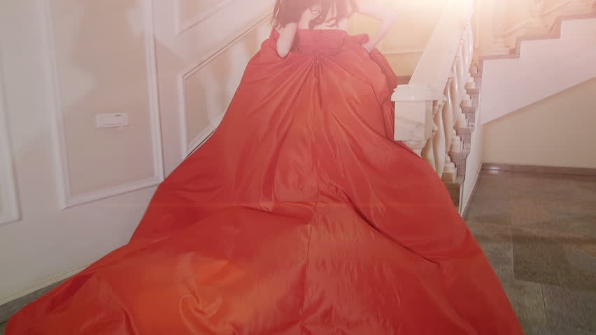 The girl in red dress running up the stairs. | Shutterstock HD Video #23509732