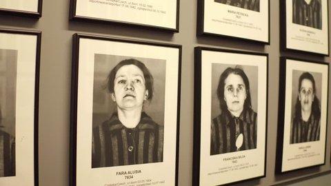 OSWIENCIM, POLAND - JANUARY, 14, 2017 Portraits of Auschwitz Birkenau female victims. German Nazi concentration and extermination camp. 4K steadicam video