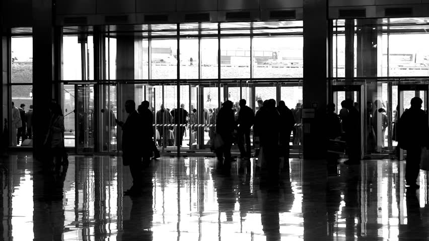 silhouette people in enter hall