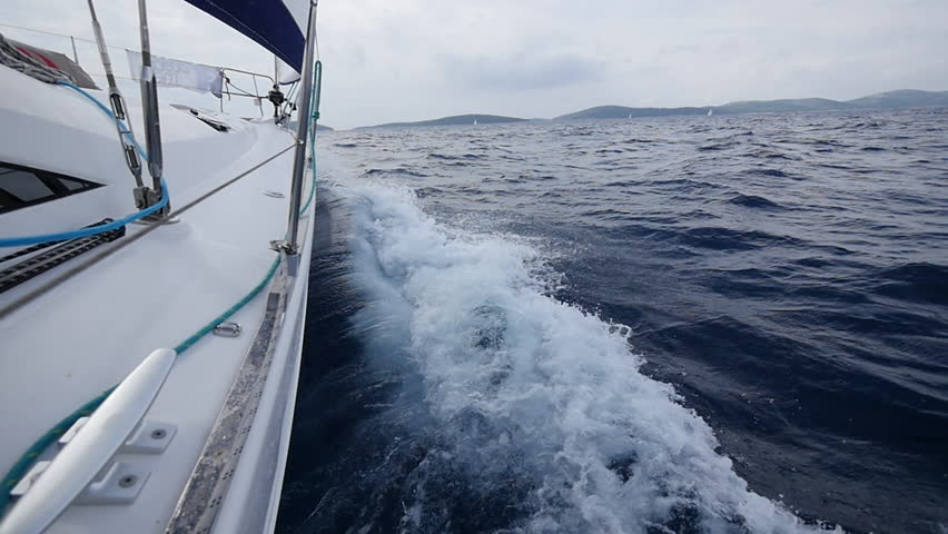 Aboard and handrails yacht on background of sea waves in Greece. Regatta. Adventures in the ocean. Slow motion. | Shutterstock HD Video #23563603