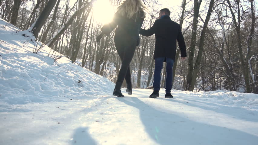 Young attractive couple happy walking in the winter park, 120FPS #23596783