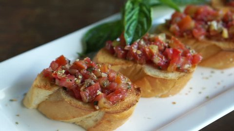 Antipasto Bruschetta, baguette slices topped with tomatoes basil mixed sauce