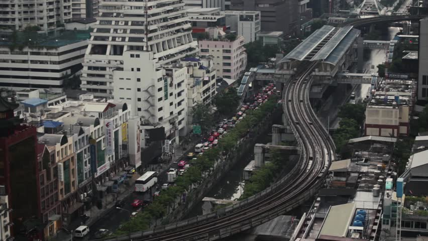 Bangkok, Thailand - 25 April, 2015: Heavy traffic and the BTS sky train in the central district of Silom | Shutterstock HD Video #23638993