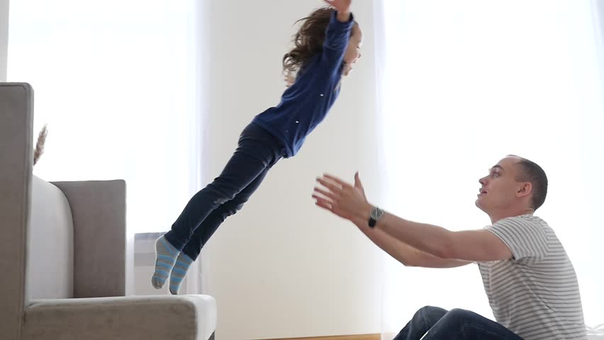 Happy Family Idyll Little Child Daughter Jump On Father Arms And They Fall On A Bed | Shutterstock Video #23641600