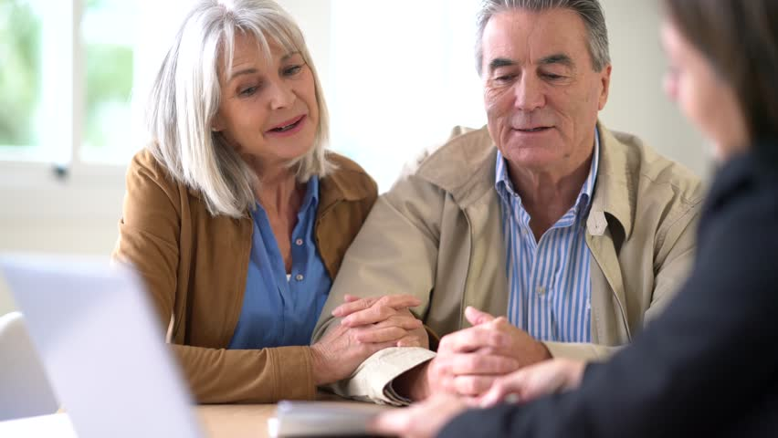 Senior couple meeting financial adviser for investment                 | Shutterstock HD Video #23654893