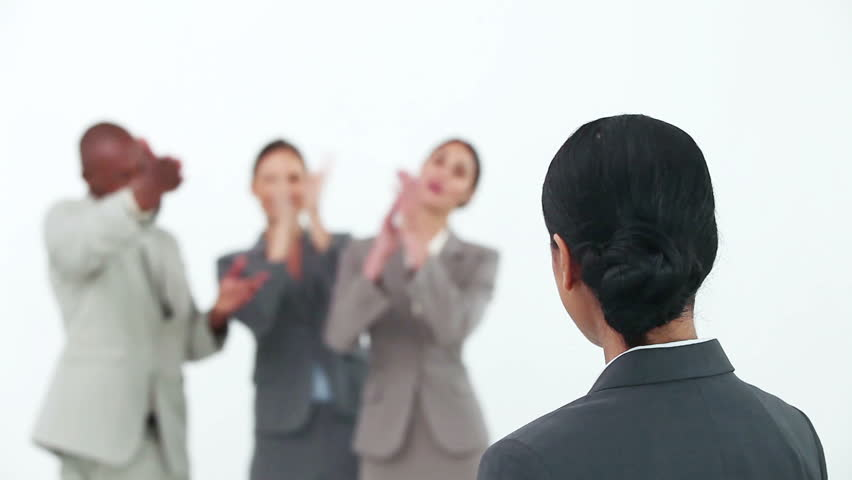 Businesswoman being congratulated by her co-workers against white background | Shutterstock HD Video #2372393
