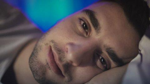 Man waking up in bed, insomnia, poor sleep. 4K