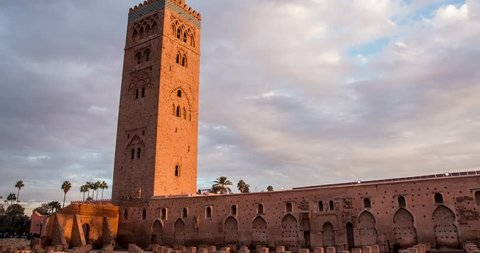Timelapse Koutoubia Mosque in Marrakech at sunset on background of clouds, Morocco