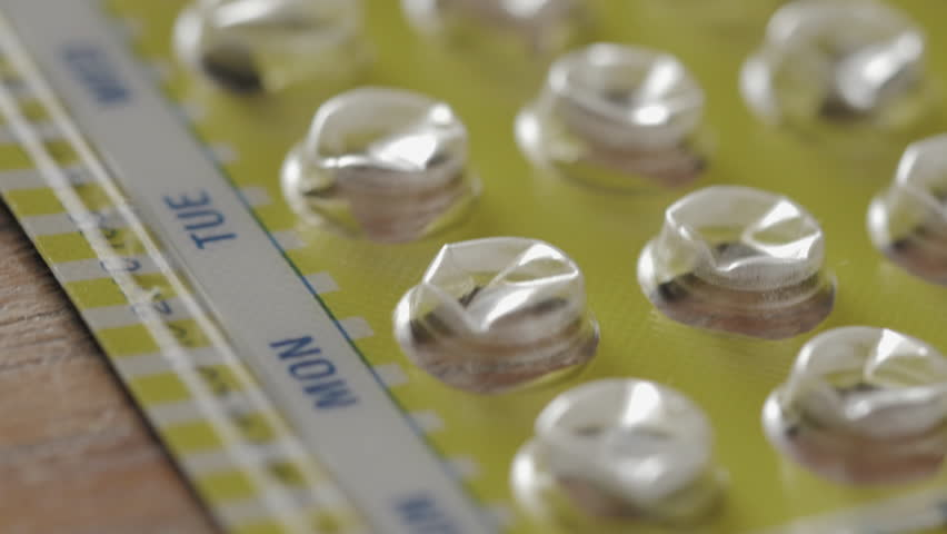 Tracking over an almost empty package of birth control pills. The oral contraceptives prevent unwanted pregnancy.
