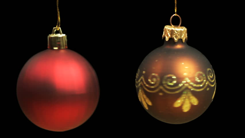 93aa3a4a8f66 Red and Gold Christmas Baubles rotating each on its own string until they  come to a standstill. These Christmas Tree Decorations were Shot on black  ...