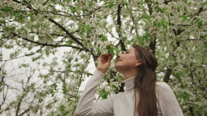 Beauty Girl Outdoor Enjoying Nature In Blooming Orchard