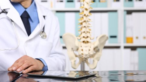 doctor checking x ray, medical and radiology concept