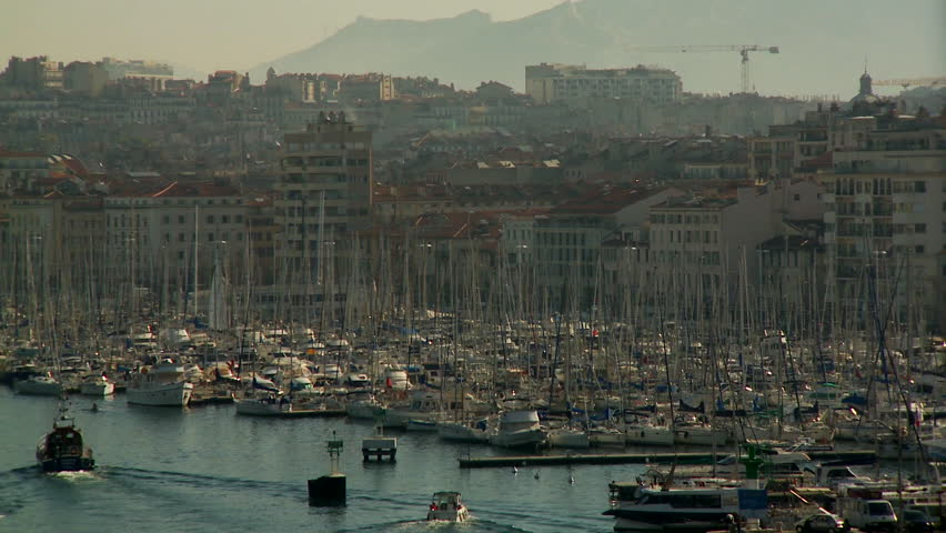 Marseilles, France - CIRCA October 2009: Large panoramic view of Marseille's cityscape; view of the port and sailboats.