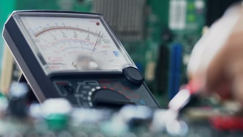 Closeup shot of a laboratory technician working with Multimeter