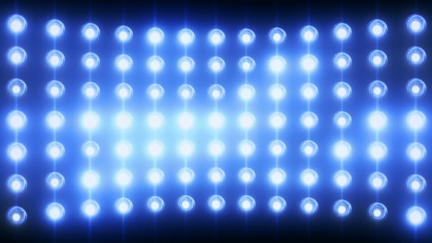 Bright flood lights background with particles and glow. Blue tint. Seamless loop.
