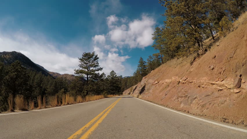POV point of view - Driving through Pike National Forest in the Winter.