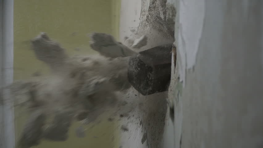 Smashing through concrete wall in slow motion