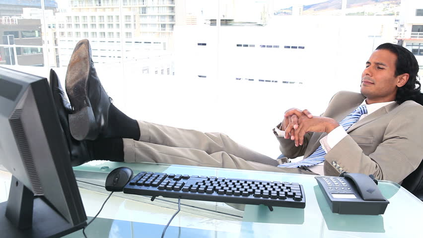 Hy Businessman The Feet On His Desk In A Office With City View Hd
