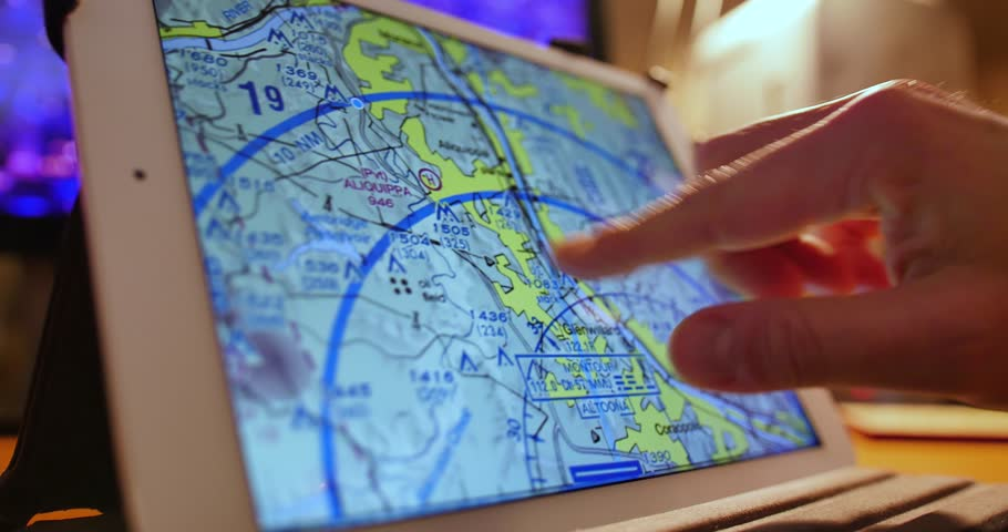 A pilot examines VFR maps of the Pittsburgh area on a tablet PC before a flight.