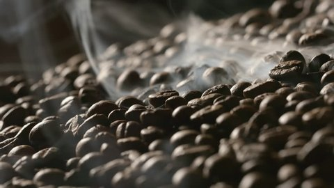 Roasted coffee beans with a smoke