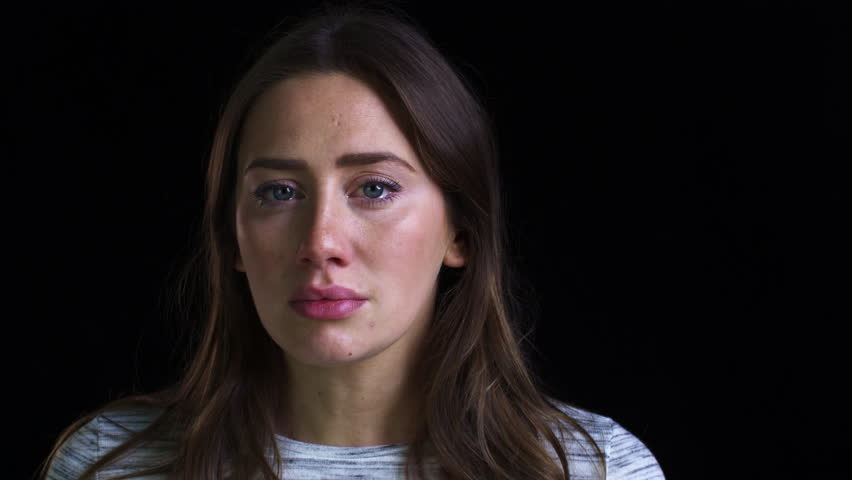 Close Up Of Unhappy Young Woman Crying Into Camera
