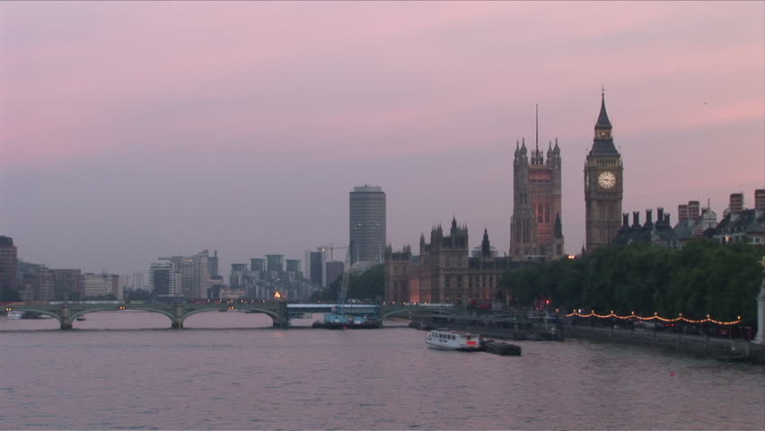 Westminster Bridge in Thames River London United Kingdom at dusk