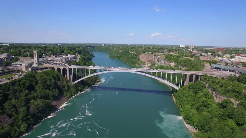 Rainbow Bridge aerial view, an arch bridge across the Niagara River gorge connecting the cities of Niagara Falls, New York, United States (east), and Niagara Falls, Ontario, Canada (west).