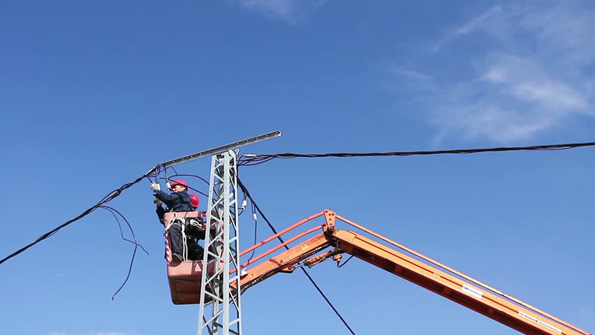 High Elevated Cherry Picker With Team Of Electricianu0027s Who Are Working On  Power Line, Pole