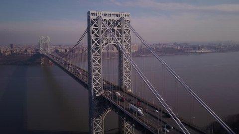 flying alongside George Washington Bridge towards New York City