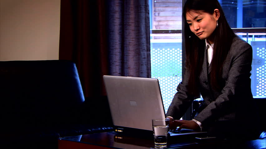 Confident japanese business woman works from an office at home