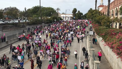 JANUARY 21, 2017: Thousands of protesters & peaceful demonstrators gather & walk down the road for Women's March on Washington in Santa Barbara, California in response inauguration of Donald Trump.